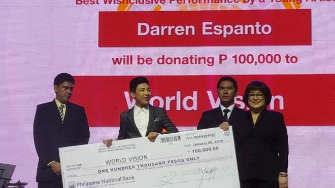Darren Espanto receives in behalf of World Vision the P100,000 cash donations from Wish FM 107.5.